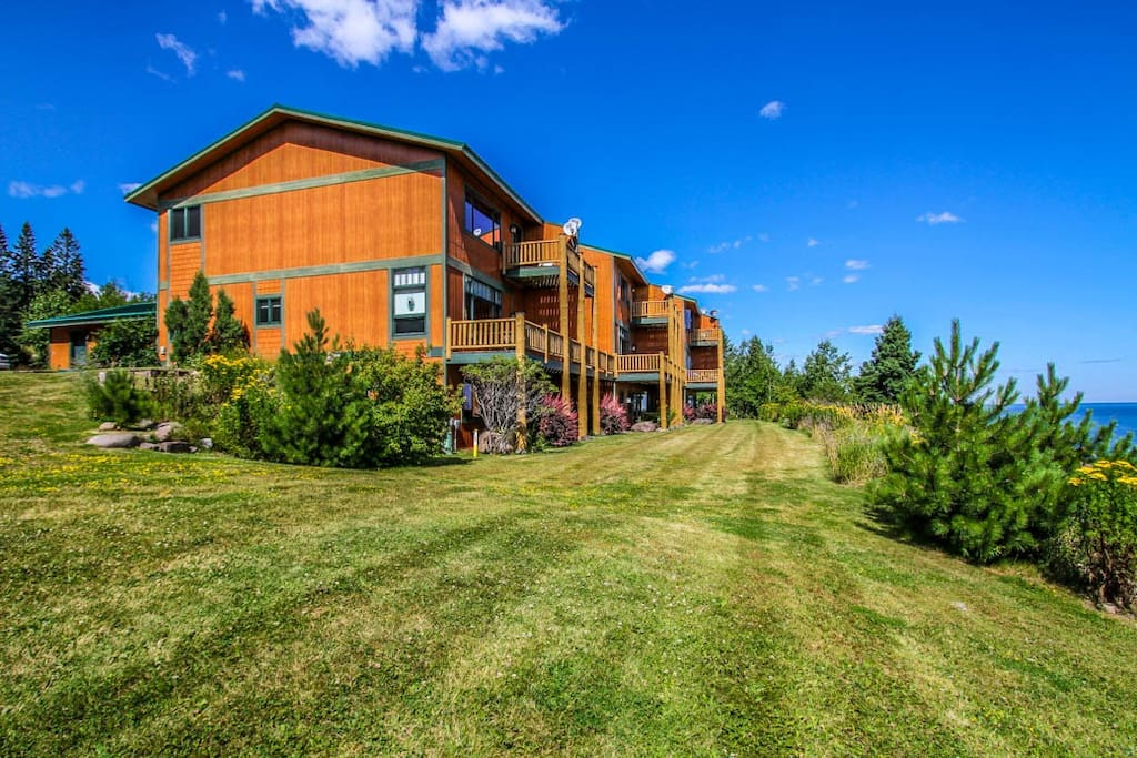 This three story unit is situated on the cliff`s edge overlooking Lake Superior.