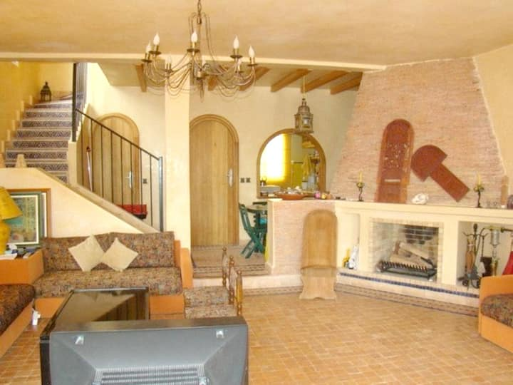 House with 3 bedrooms in El Mansouria, with wonderful sea view, shared pool, furnished garden