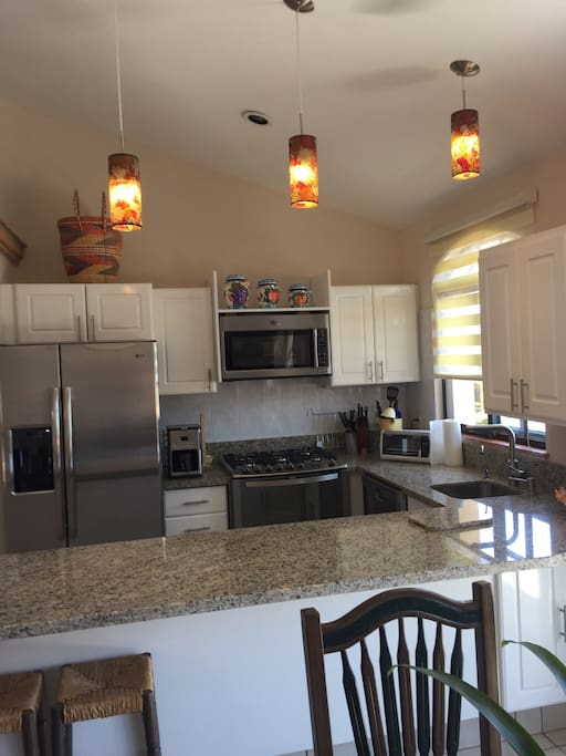 Newly renovated kitchen with new appliances and granite countertops