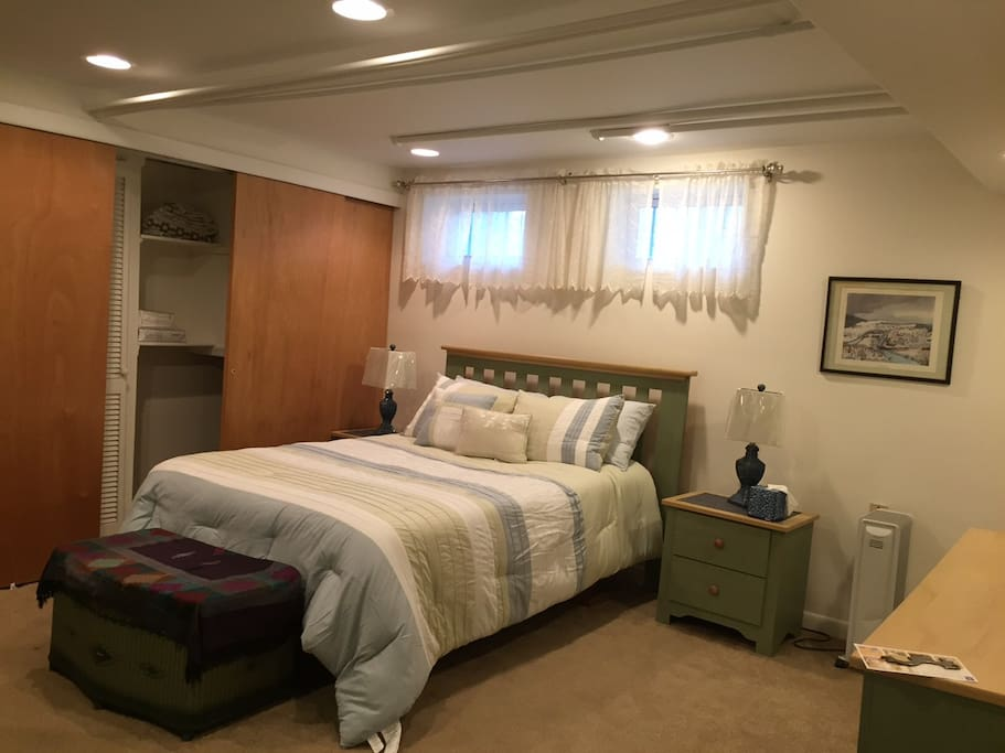 Downstairs, enjoy a comfy full sized bed in your spacious room, with space underneath the bed to stash your suitcase, and fresh linens in the closet.