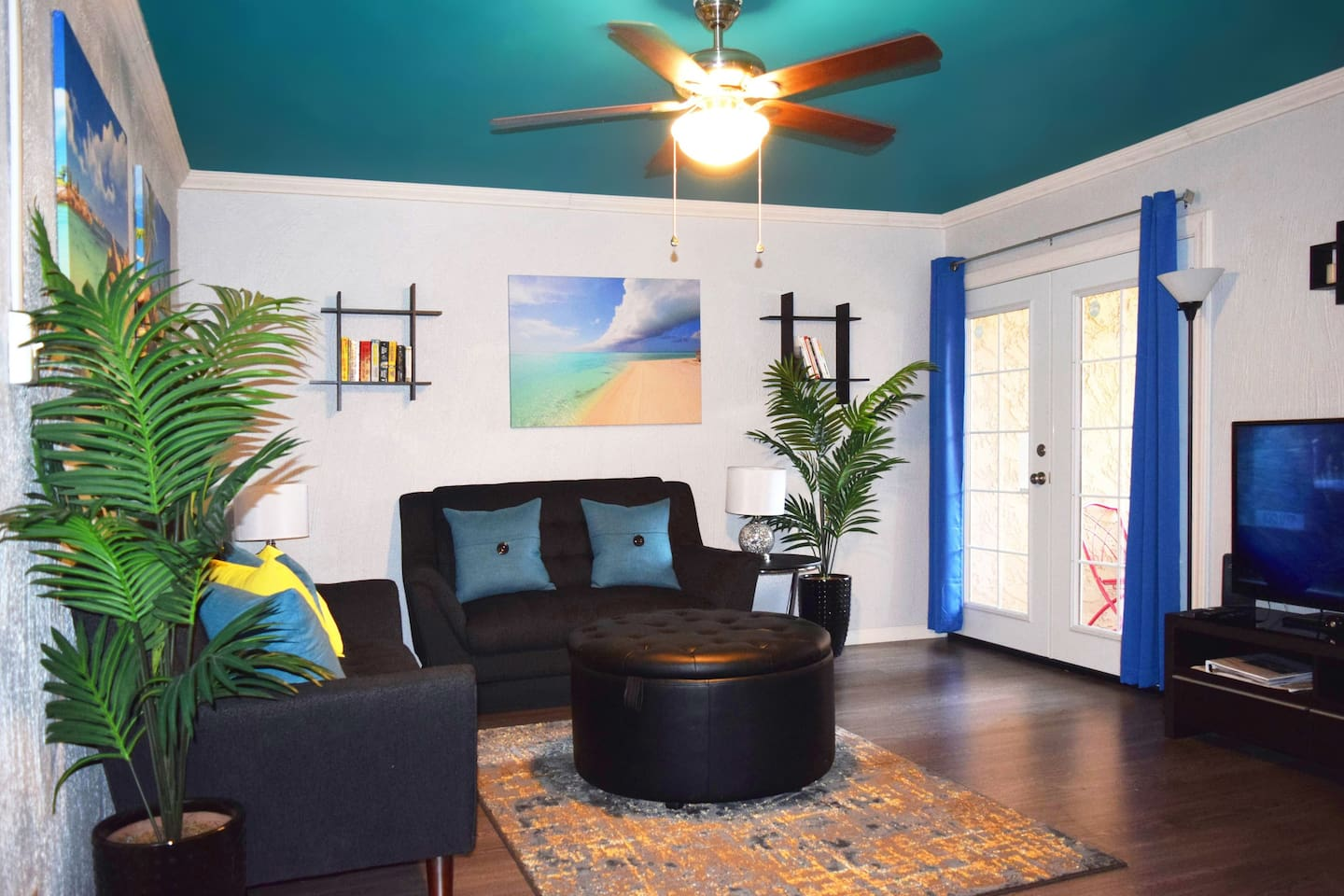 Lounge in the tropical themed living room and a private patio near the pool area.