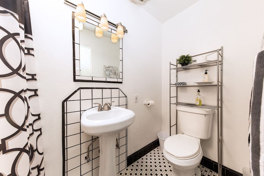 This quaint black-and-white bathroom is the perfect addition to the apartment, making it a two bedroom and two bathroom space.