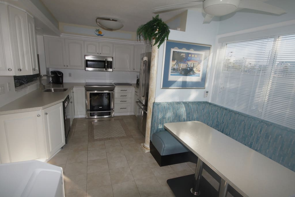 Kitchen area with Electrolux appliances and booth seating