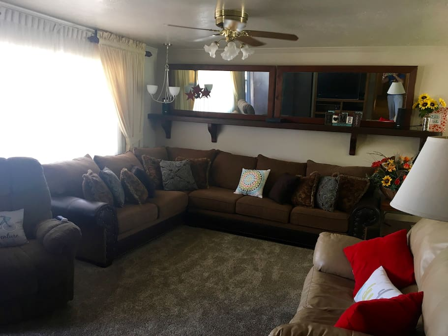Main living room with big sectional, love seat and Lazy Boy Recliner