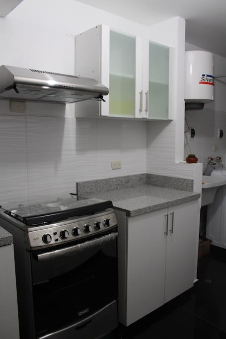 Spacious kitchen with brand new appliances, dishes, cutlery etc.