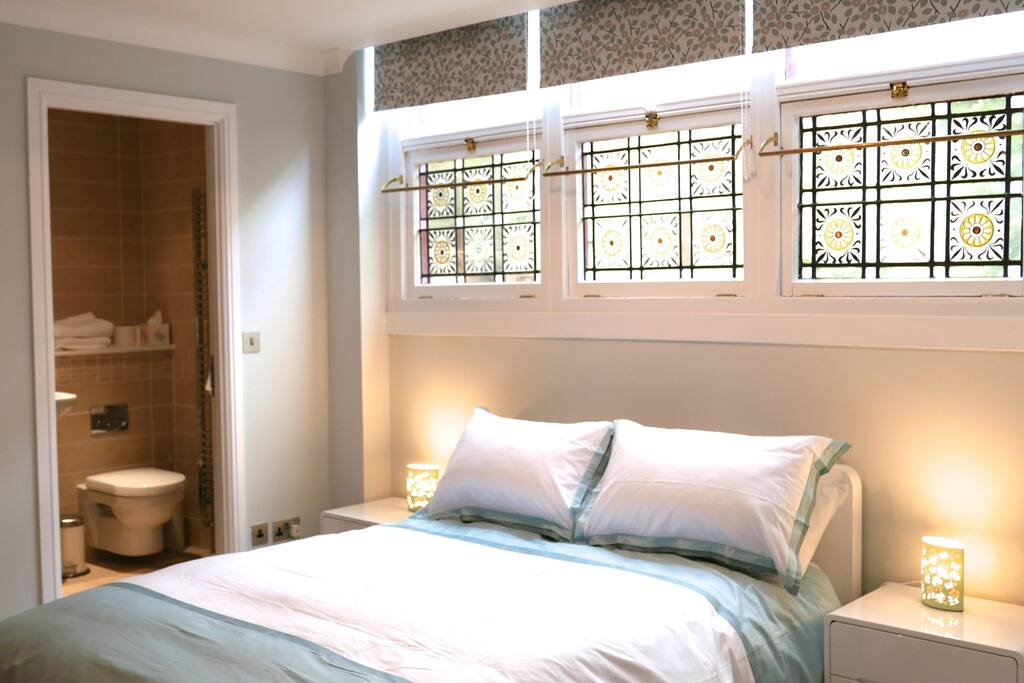 Master bedroom with en-suite shower room, fitted wardrobes, stained glass windows, high quality bedlinen and blinds by renowned designer Natasha Marshall.