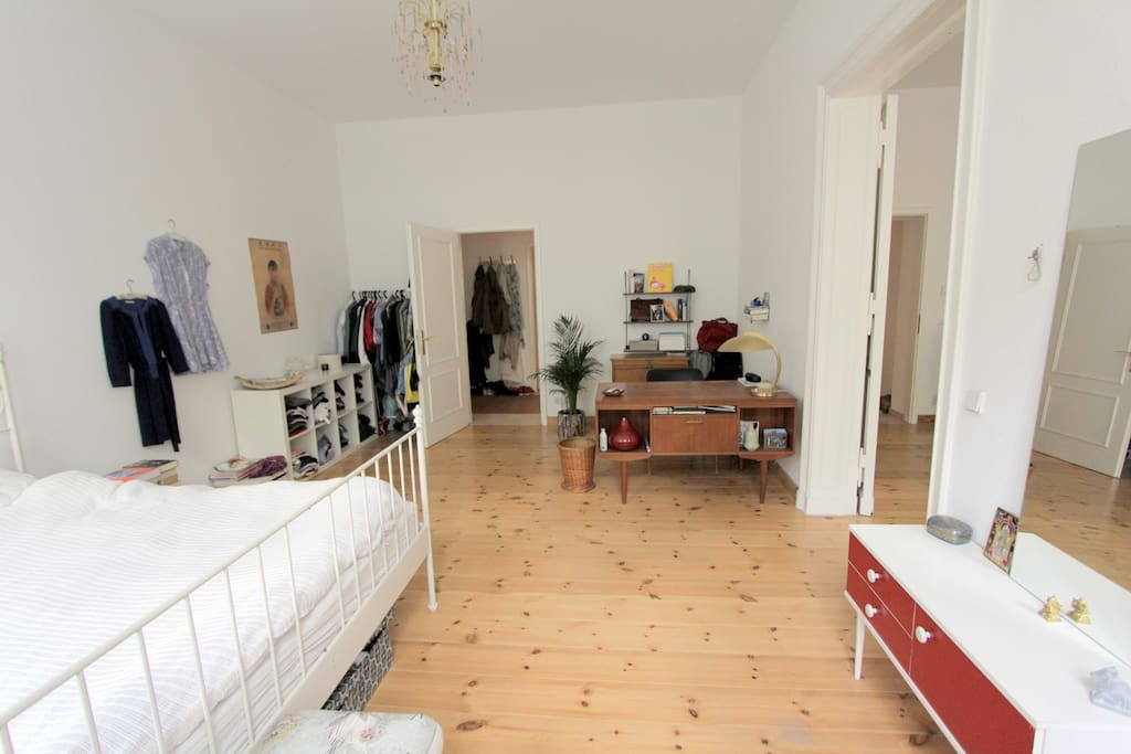 Vintage interior, wooden floors. One additional mattress underneath the bed