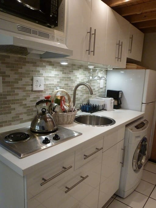 Kitchen with electric burner and washer/dryer