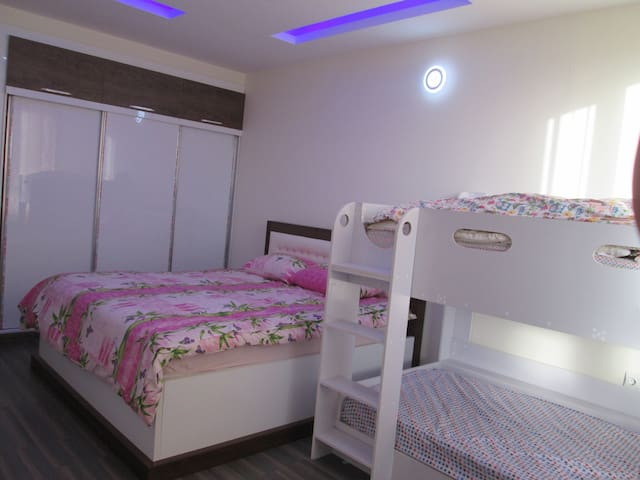 Bedroom with king bed & child double beds