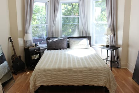 Enjoy our entire apartment spanning 2 floors w/ 2 beautiful bedrooms and a giant work space w/ 2 desks. Located in historic Prospect Lefferts Gardens. One block from the subway & express bus. Just blocks from Prospect Park. Complete w/ projector!