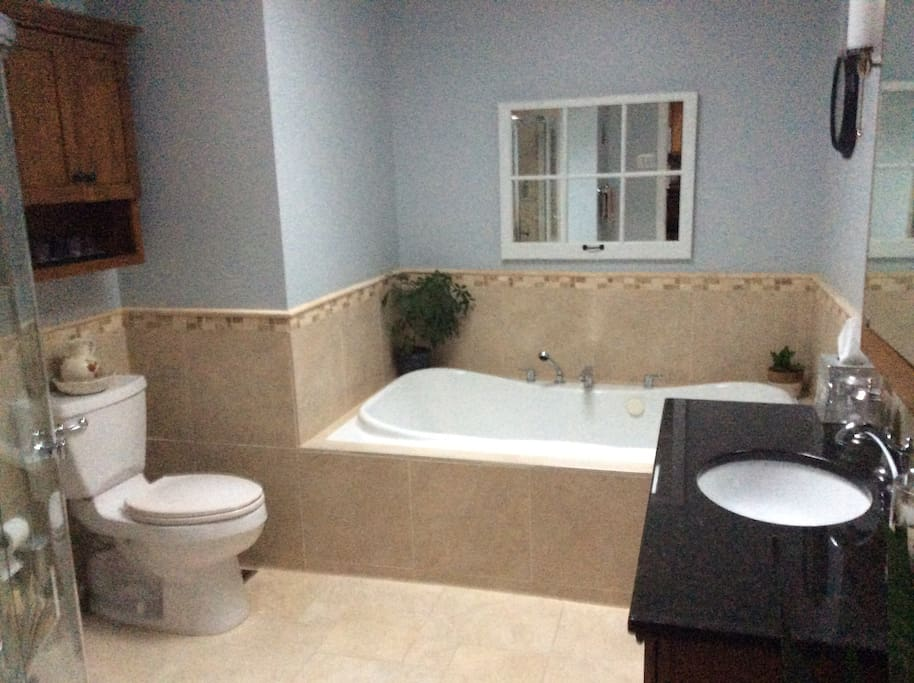 After a long day enjoy a leisurely soak in the Jet Tub or take a quick shower in the separate walk-in shower.