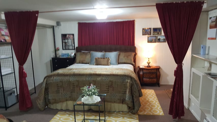 The big comfortable king size bed in it's rightfull place and space to keep you  comfortable