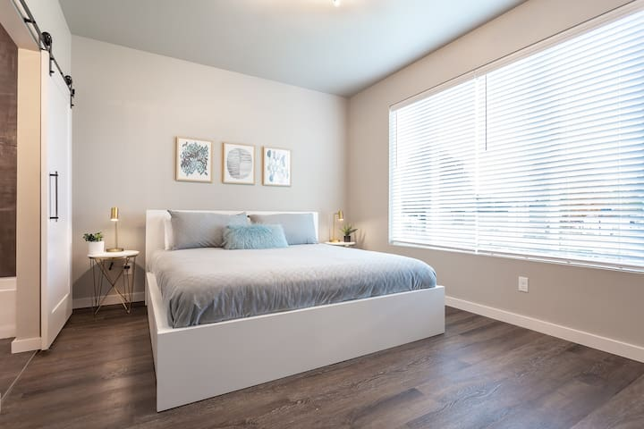 Master Bedroom with King Bed and storage drawers beneath.