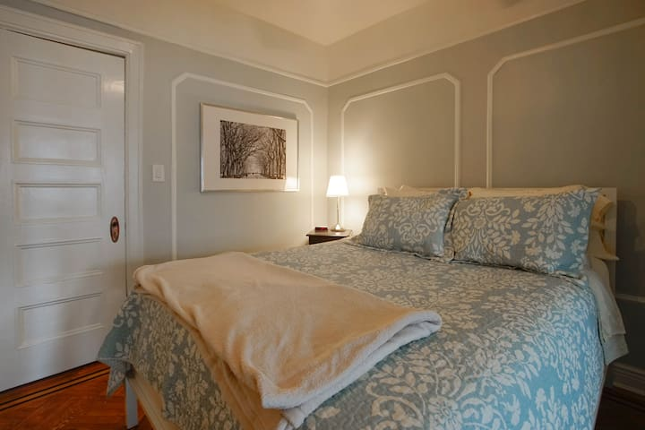 Bedroom features a queen-sized pillow-top mattress, ceiling fan, closet, luggage racks