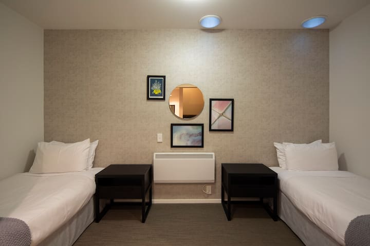 The third bedroom of this contemporary apartment comes complete with two single beds; ideal as a kid's or friend's room