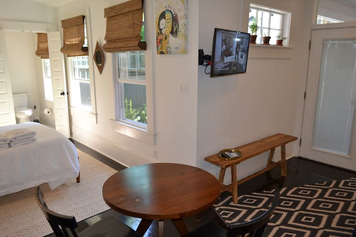 Our guest house is cozy with a purposeful design.  There is a space to lounge, eat/work, and rest.  Enjoy a  cabinet full of amenities such a coffee maker, hair dryer, and steamer.  And a mini-fridge and microwave to enjoy yummy NOLA leftovers.