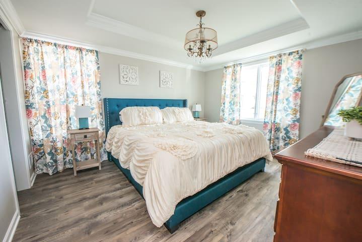 KING en-suite with walk in closet on FIRST FLOOR!