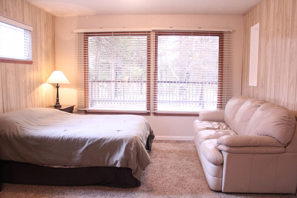 """Other Side of Upstairs Master Suite with Full Bed, Couch and wall mounted 40"""" LCD TV"""