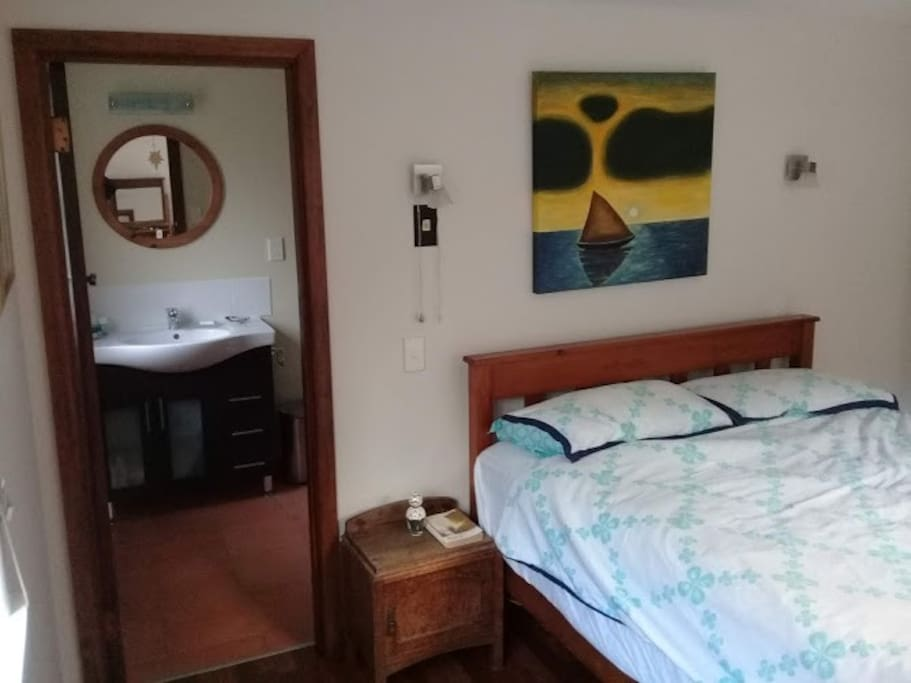 This is the roomy double bedroom with adjoining ensuite bathroom