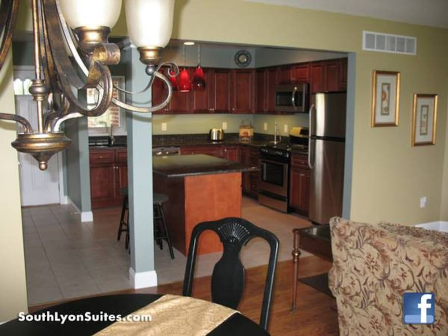 Open concept kitchen, dining and living room