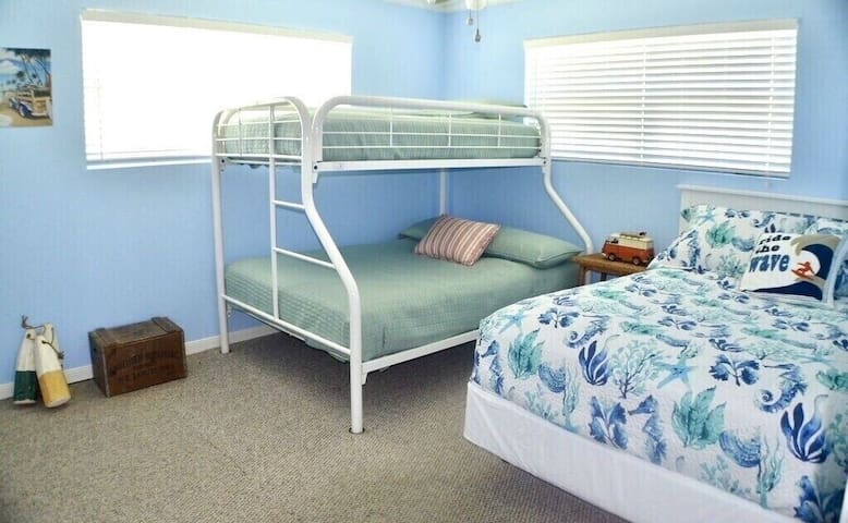 Second bedroom has two comfy full size beds with twin bunk