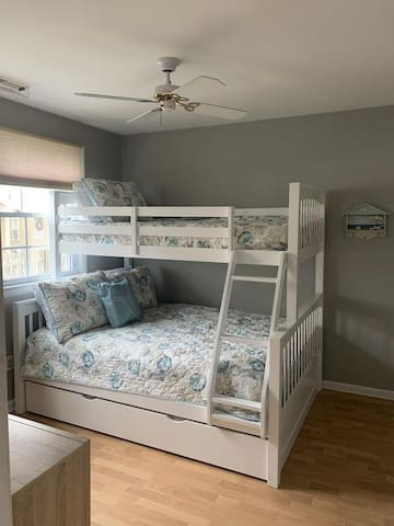 Full over twin Bunk w/ a twin trundle
