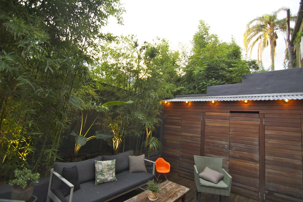 outdoor space  with bbq and night lighting