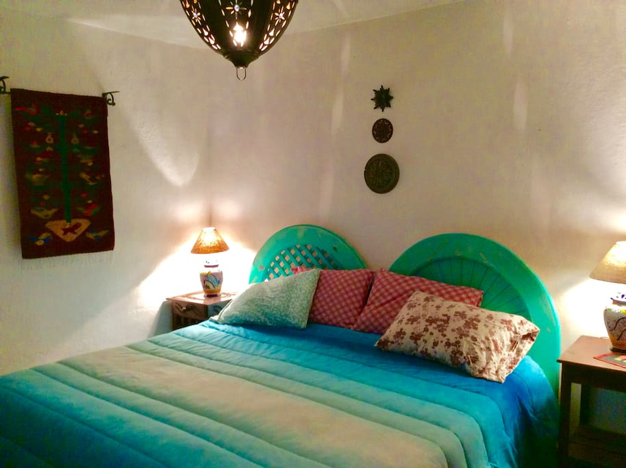 The small guest room has either a king-size bed or two twin beds.