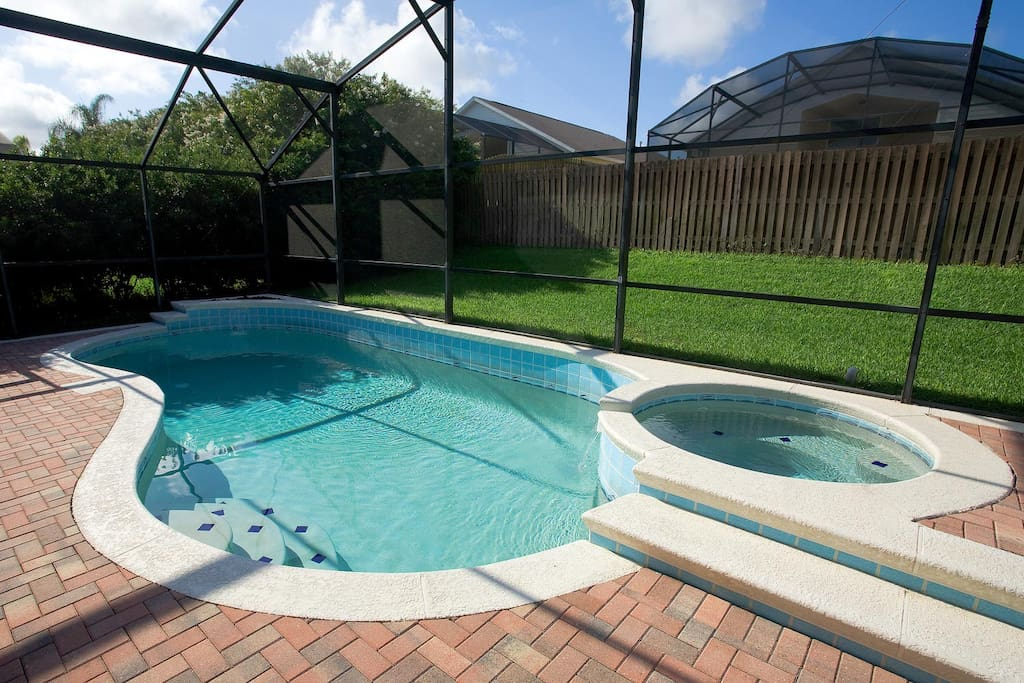 North-facing private pool and spa with patio furniture and gas barbecue grill