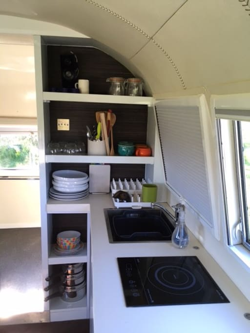 The kitchenette, wet room beyond