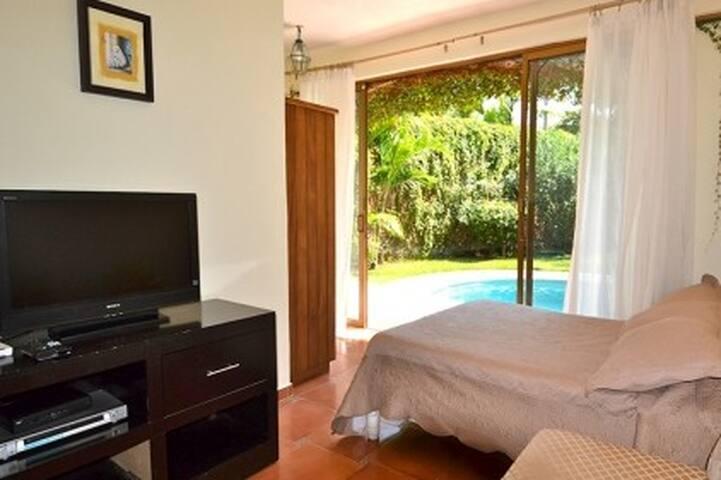 Pool Bedroom - TV lounge
