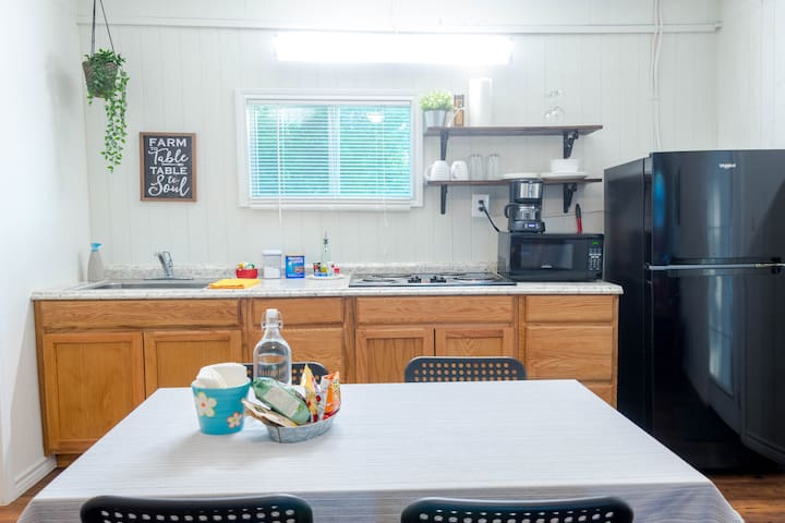 Kitchenette with: -Microwave -Cooktop -Coffee maker -Fridge -Dishes -Pans, pot and more to cook