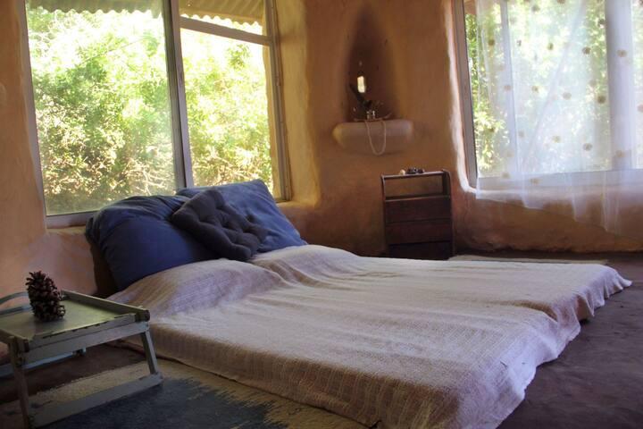 main room set as bedroom