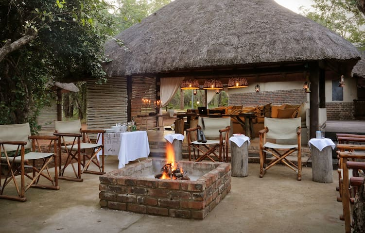 Fire pit & lounge where we braai and our guests sit around the fire at night while admiring the African sky, visiting Bush Babies, our local Genet and listening to lions roaring from the Kruger.