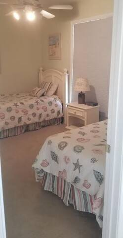 Twin beds in the 3rd  bedroom with TV