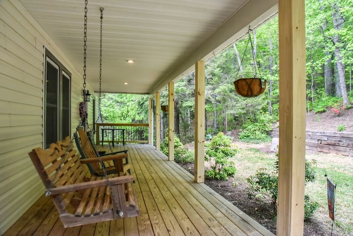 Front porch with swing to enjoy the peaceful Mtn