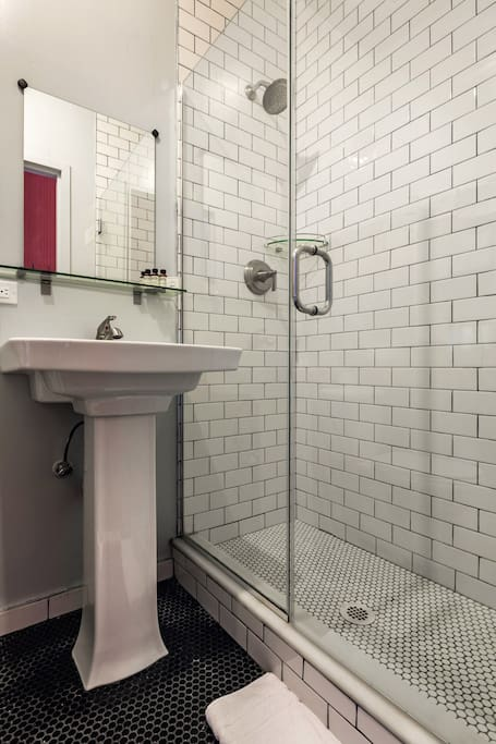 Subway tile and penny tiles bathrooms. An elegant combo.