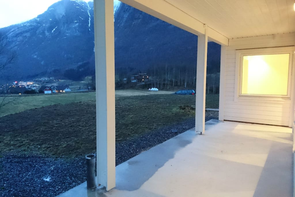 Outside area facing both fjord and mountains. evening sun untill around 09:00 (even longer in the middle of the summer)
