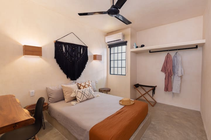 Master bedroom - accessories are handmade by local Mayan artisans, memory foam mattress, soft cotton and linen bedsheets and decorations, 2 bathrobes for you to enjoy, and a working desk with high speed internet.