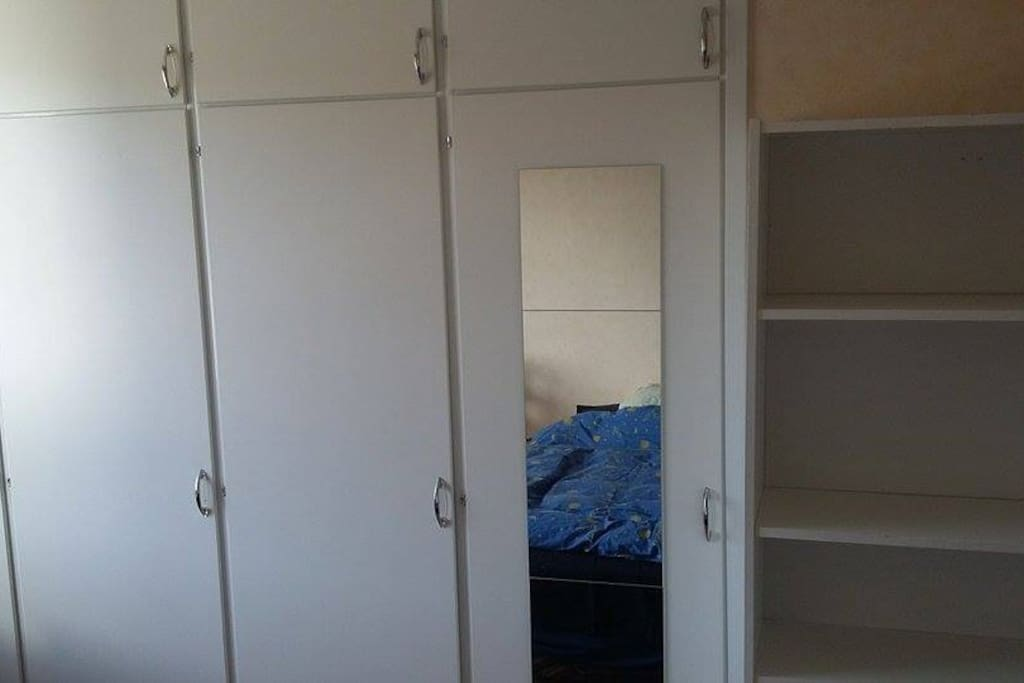 Mirror, shelves and tons of wardrobes.