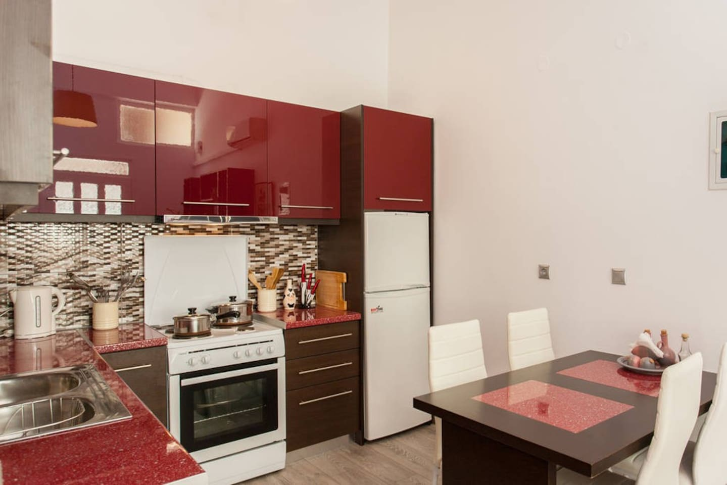 kitchen with fridge, stove and dining area