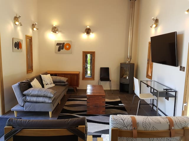 Living Area with underfloor heating and a modern Swedish woodburning stove.