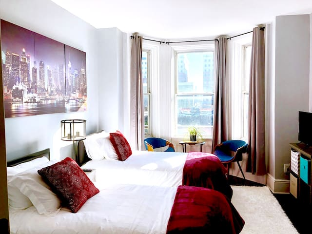 Large Bedroom with 2 Twin Beds.  Views of NYC World Trade Center and Hoboken.