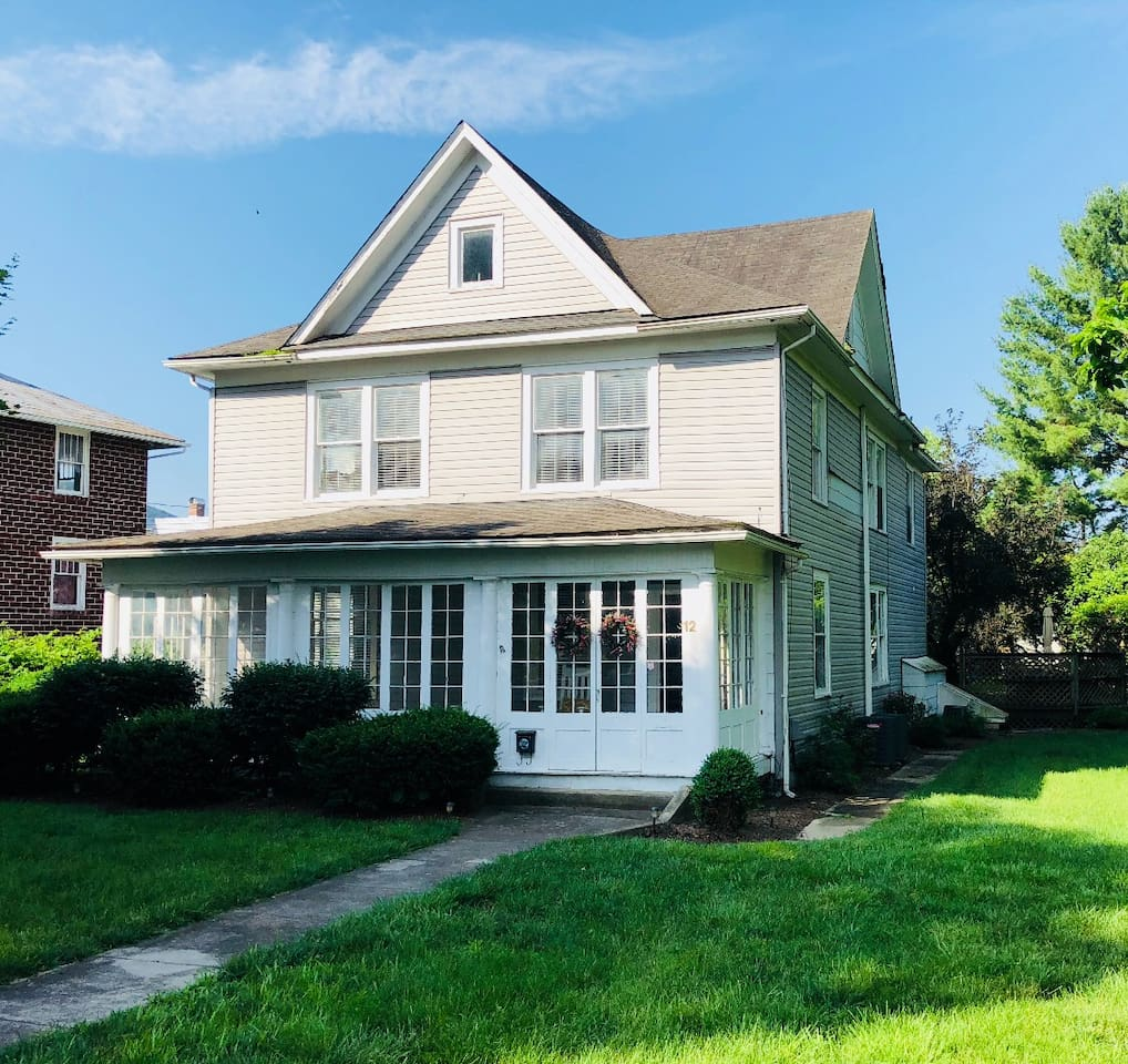 Front of Home- located just around the corner from Main Street which has plenty of restaurants and shops within walking distance! Large spacious yard is perfect for outdoor games and entertaining.