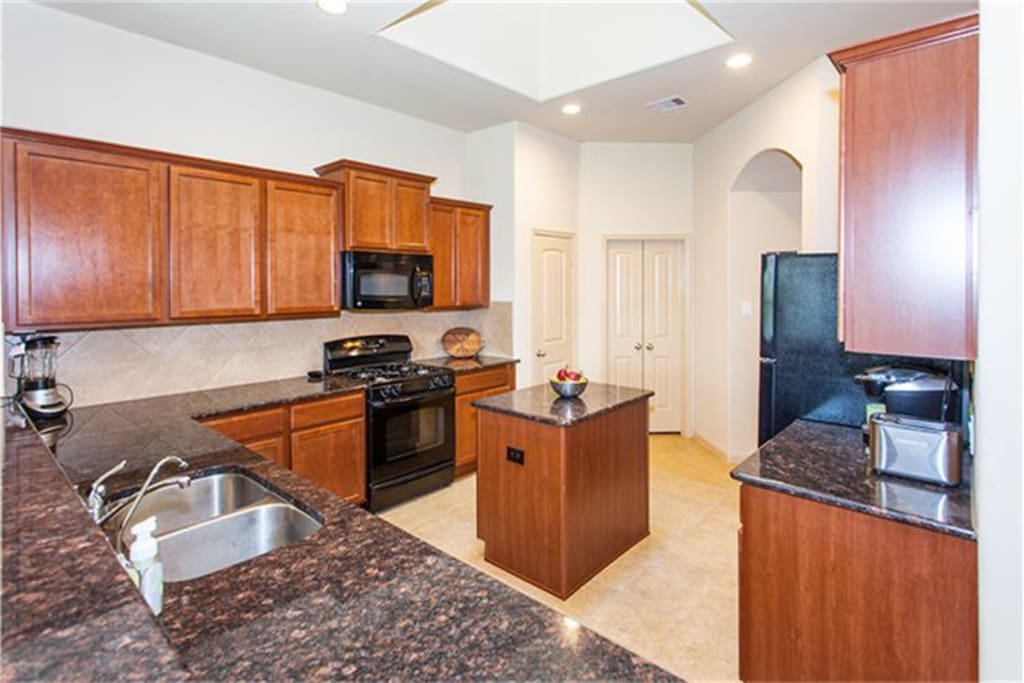 Large kitchen with island, skylight, and plenty of counter space!