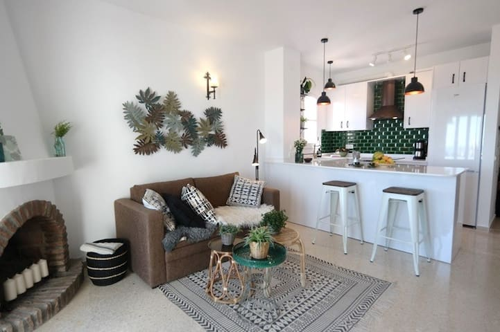 Open plan living - dining - kitchen with breakfast bar