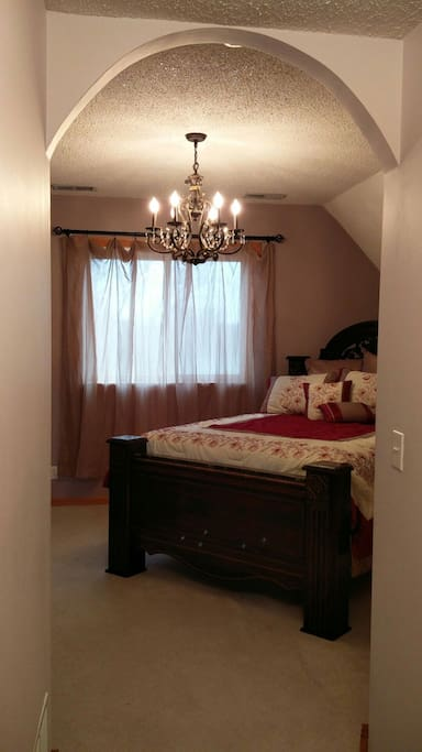 Master suite has very comfy Queen bed, chandelier, locking doors, laundry, and lockable access to full bath.