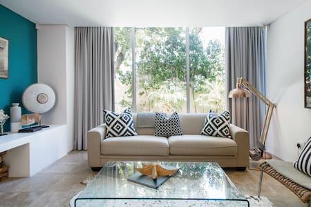 Elegant Villa with Coastal Views Nestled below Lions Head