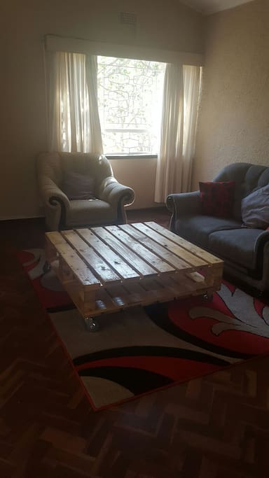 The coffee table is homemade from a pallet.
