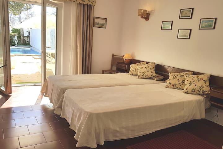 En-suite Master Bedroom with doors to the sunny pool area